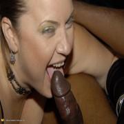 Chunky mature slut munching on a black cock