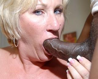 Kinky mama getting two black cocks at once