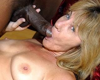 Kinky mama munching on a bunch of black cocks